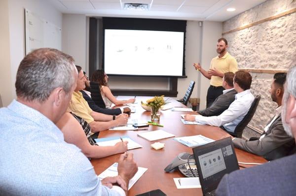 Skyline Energy team member Matt Kennedy presenting report in office meeting room